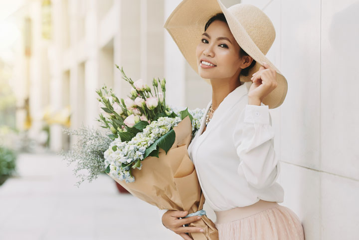 elegant well dressed asian woman with flowers