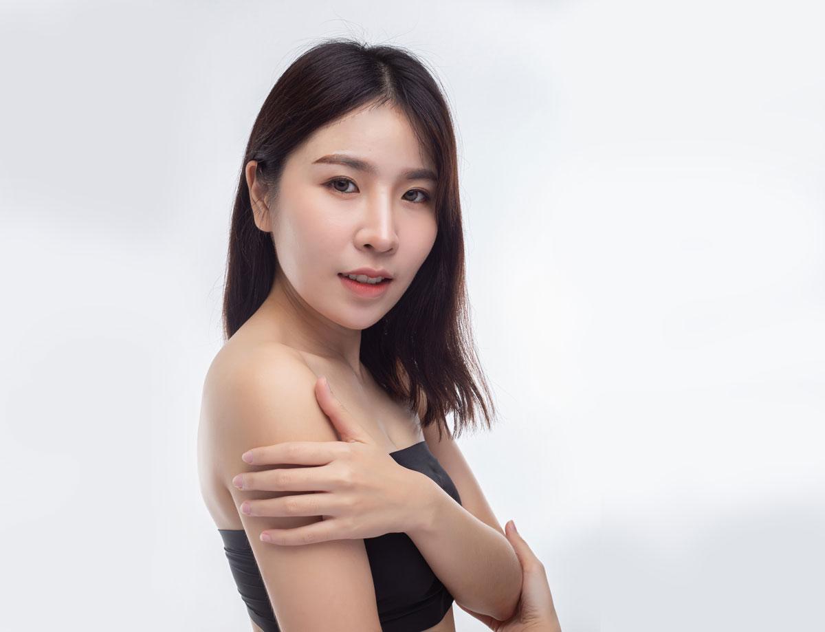Thai woman wearing black strapless blouses